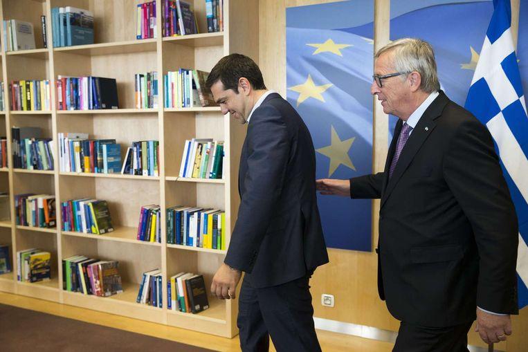 De Griekse premier Alexis Tsipras en Commissievoorzitter Jean-Claude Juncker in Brussel. Beeld afp