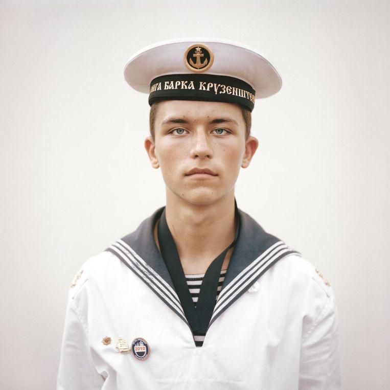 Portret van Kirill Lewerski, 16 jaar, matroos op het Russische tallship Kruzenstern, gemaakt op Sail 2010. Beeld Joost van den Broek