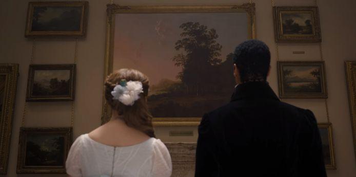 De hoofdpersonen Daphne en Simon uit de serie Bridgerton, op het moment dat ze naar het schilderij van Aelbert Cuyp kijken.