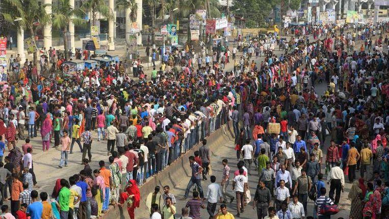 Protesten tegen de slechte werkomstandigheden en lage lonen in de textielindustrie in Gazipur, Bangladesh. Beeld AFP