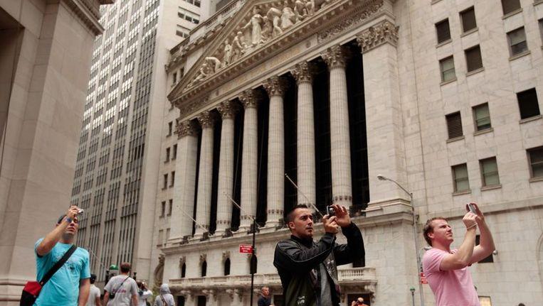 Toeristen zijn weer terug in de straten van New York. Beeld afp