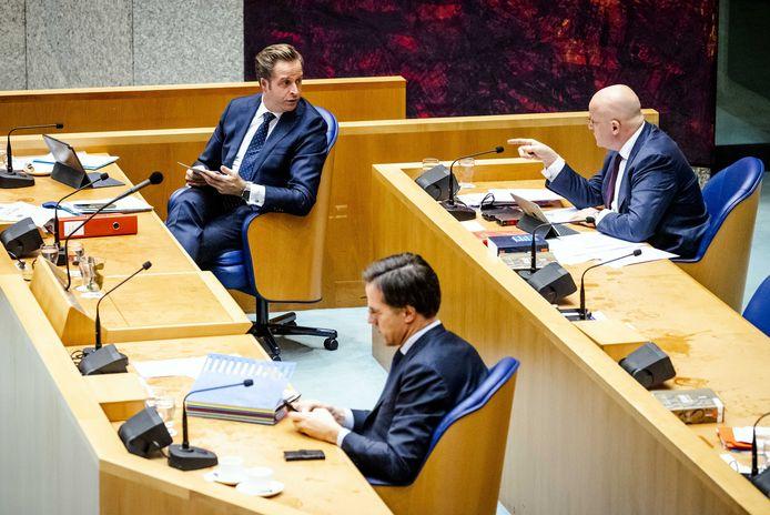 Ministers Hugo de Jonge, Mark Rutte en Ferdinand Grapperhaus.