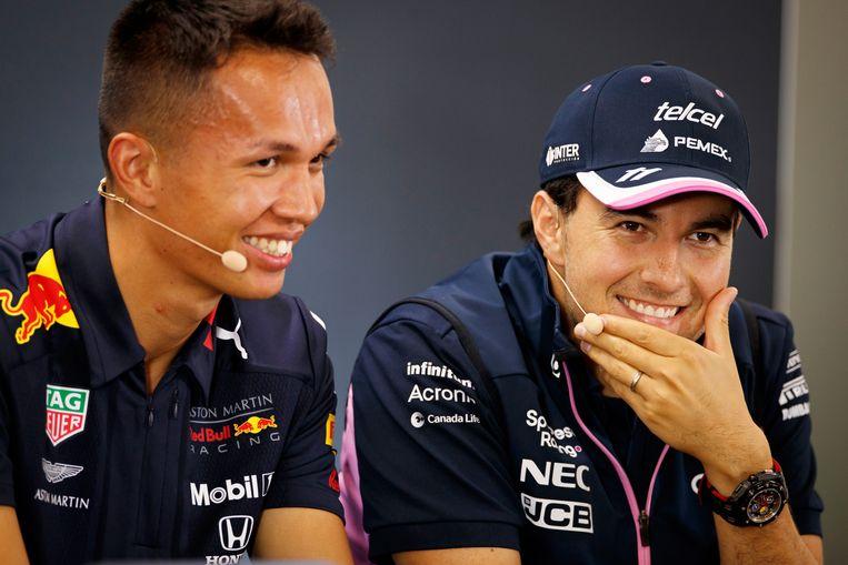 De Mexicaanse Formule 1-coureur Sergio Pérez (r) van Racing Point en de Thais-Britse coureur Alexander Albon van Aston Martin Red Bull Racing op een persconferentie na de Grand Prix Formule 1 van België in 2019.   Beeld EPA