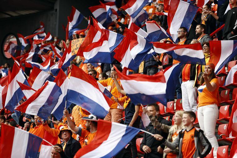 Supporters tijdens de vriendschappelijke wedstrijd tussen Nederland en Georgië in Stadion De Grolsch Veste. Beeld ANP