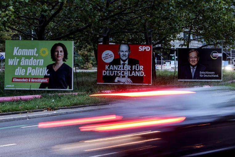 De verkiezingsposters van de Groenen, SPD en CDU.  Beeld EPA