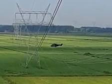 Helikopter Defensie vliegt onder hoogspanningskabels door met werklui in mast: 'Levensgevaarlijk'
