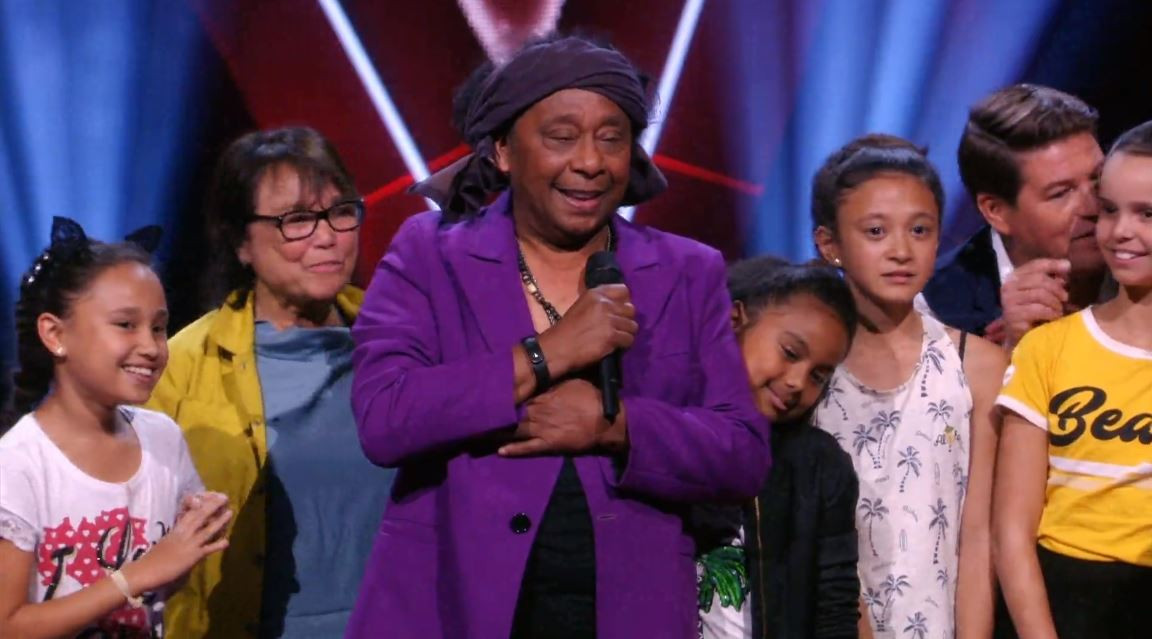 Jimi Bellmartin met zijn kleinkinderen op het podium