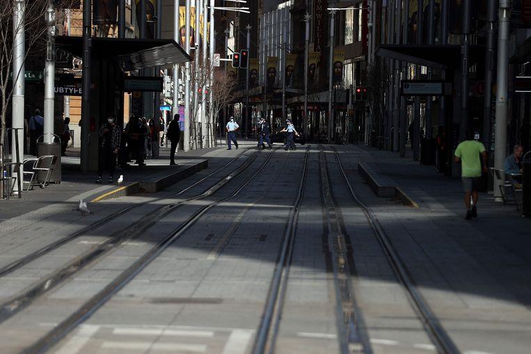 Zo goed als lege straten in het centrum van Sydney. Beeld AFP