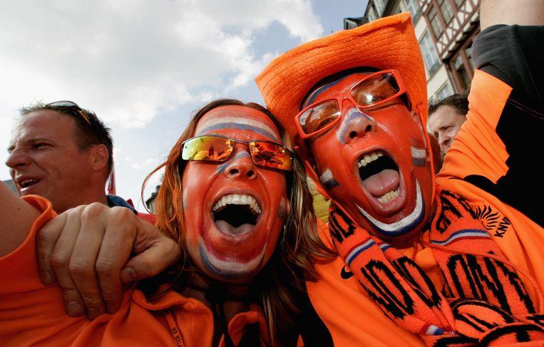 Wie denkt er aan corona als Nederland scoort?  Beeld Getty Images