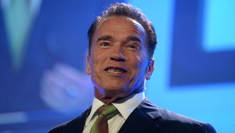 Arnold Schwarzenegger, donderdag als spreker op een financiële conferentie in Sydney. Beeld epa