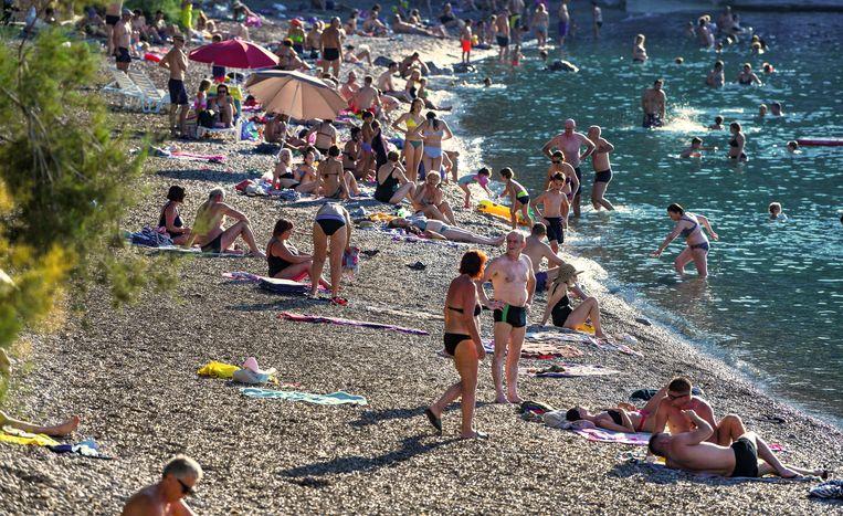 'Ons land is bezet door toeristen' zegt Horvat. Zoals hier an de kust van het Kroatische dorpje Komiza.   Beeld BELGAIMAGE