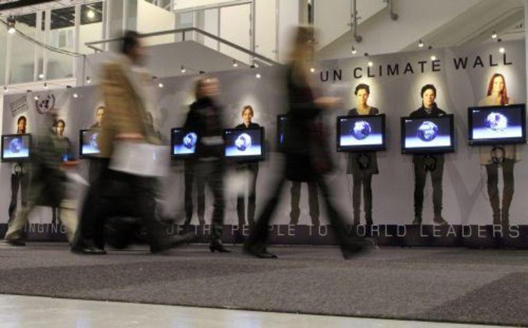 Veel deelnemers van de Klimaattop kampen met blaren vanwege het vele lopen tussen de vergaderzalen. ANP Beeld