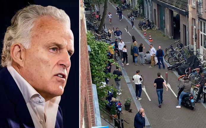 Peter R. de Vries ligt zwaargewond op de grond, terwijl tal van getuigen toekijken.