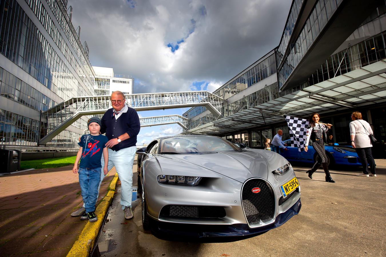 Michel Perridon met een Bugatti in actie voor de stichting Kanjer Wens die dagjes uit houdt voor kinderen met kanker, hun ouders en broertjes en zusjes.
