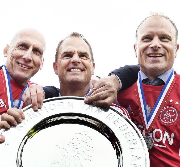 April 2014. Frank de Boer en zijn assistenten Jaap Stam en Dennis Bergkamp. Beeld Guus Dubbelman / de Volkskrant