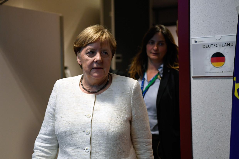 De grote verliezer na afloop van de bekendmaking van de vier Europese topfuncties: Angela Merkel. Beeld AFP