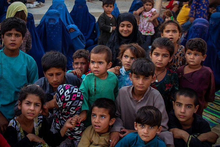 Vluchtelingenkinderen in de stad Kunduz in het noorden van Afghanistan. Beeld AFP
