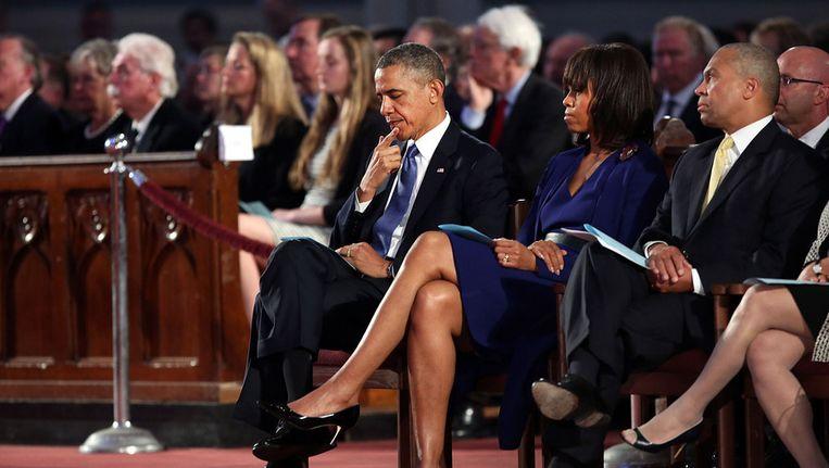 Barack en Michelle Obama bij de herdenkingsdienst in Boston. Beeld getty