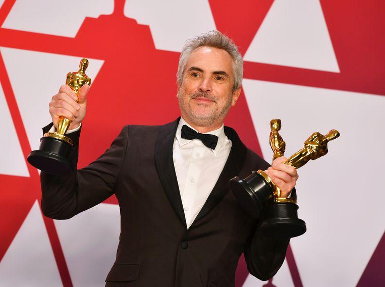 De Mexicaan Alfonso Cuarón, de regisseur van 'Roma', won drie Oscars: beste regisseur, beste cinematografie en beste niet-Engelstalige film. Beeld Jordan Strauss/Invision/AP