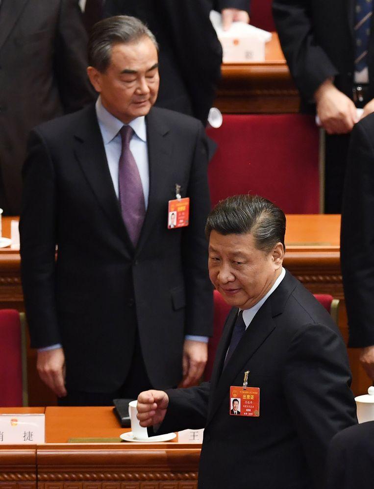Chinese President Xi Jinping (voor) tijdens de jaarlijkse bijeenkomst van het nationale volkscongres. Beeld AFP