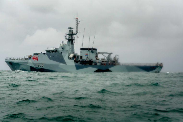 HMS Tamar, een Brits marineschip, nabij Jersey. Beeld Getty Images