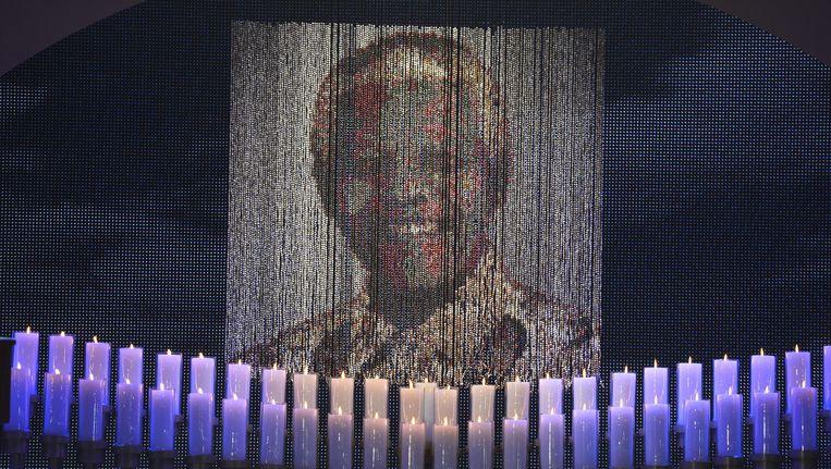 Kaarsen branden tijdens de begrafenis van oud-president Nelson Mandela. Beeld AFP