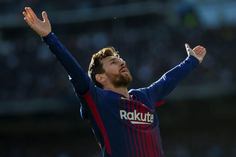eLionel Messi nadat hij een doelpunt heeft gescoord tegen Real Madrid, afgelopen december. Beeld EPA