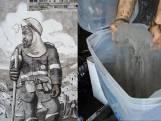 Kunstenaar maakt muurschildering met as van Amazonegebied