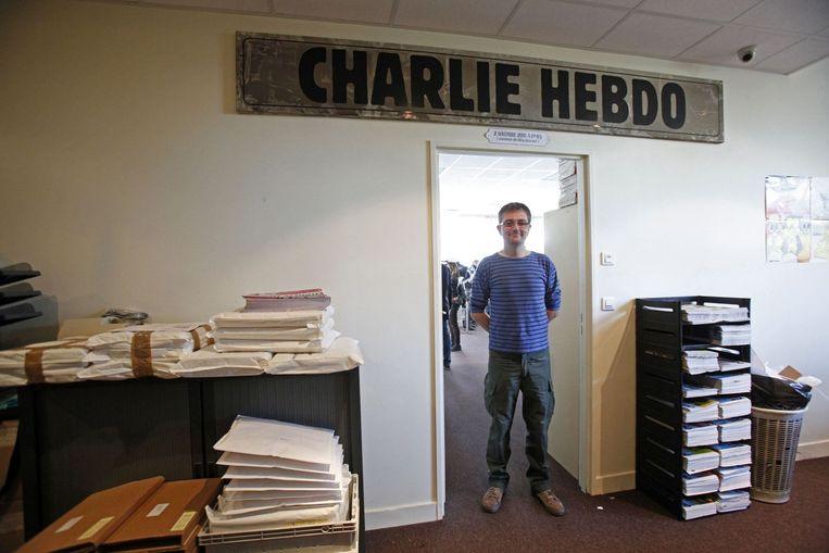 Charb in de redactielokalen van Charlie Hebdo. Beeld REUTERS