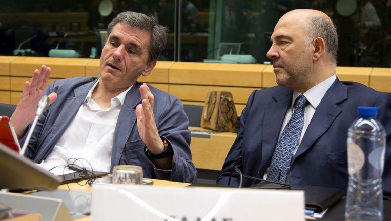 Tsakalotos en Moscovici. Beeld AP