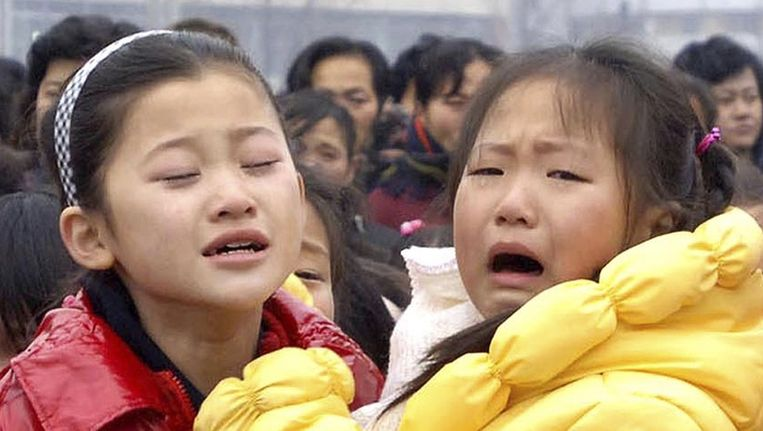 Noord-Koreanen huilen om het verlies van hun leider. Beeld reuters