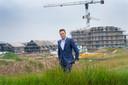 Joost van der Werf, de 'man van 1 miljoen huizen'. Op de  achtergrond worden nieuwe huizen gebouwd in Lent, op fietsafstand van Nijmegen.
