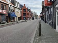 In Baarle-Hertog is het doodstil, luttele meters verder gaat het dagelijkse leven gewoon door