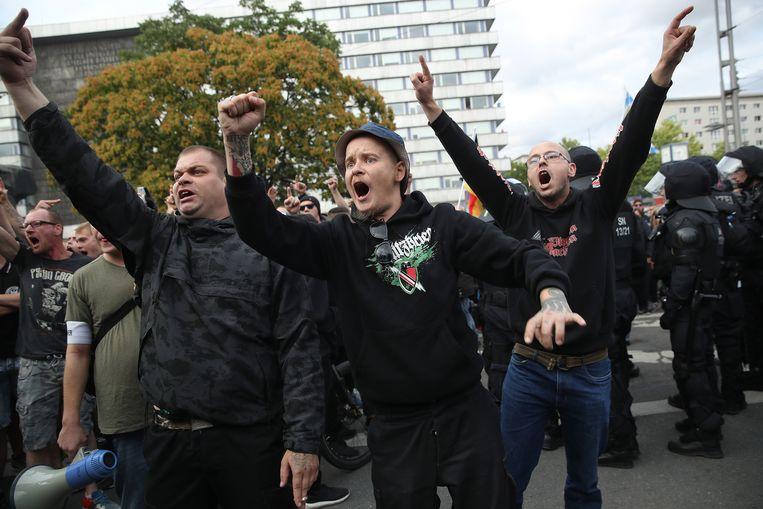 Aanhangers van extreem-rechts tijdens protesten in Chemnitz. Ze zijn de straat opgegaan na een dodelijke steekpartij met twee immigranten als verdachten. Beeld Getty Images
