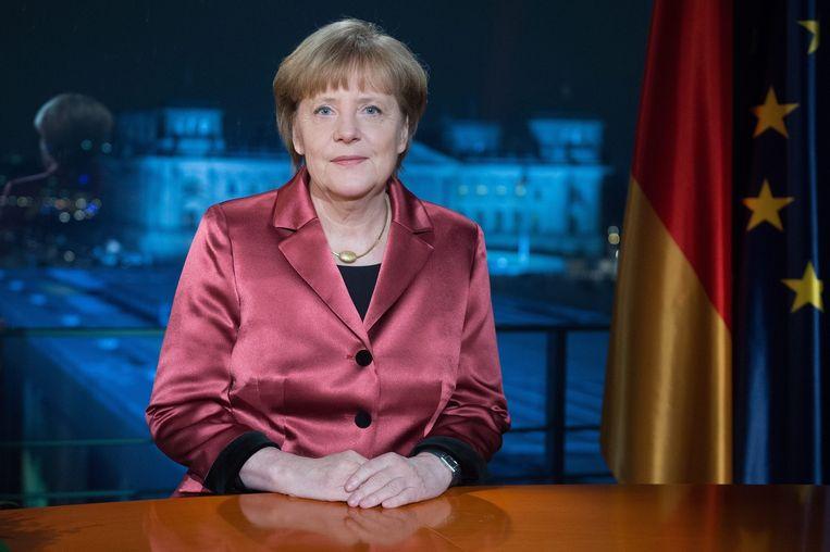 Angela Merkel tijdens haar nieuwjaarstoespraak. Beeld epa