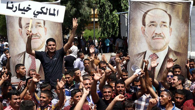 Aanhangers van premier Al-Maliki demonstreren in Bagdad. Beeld EPA