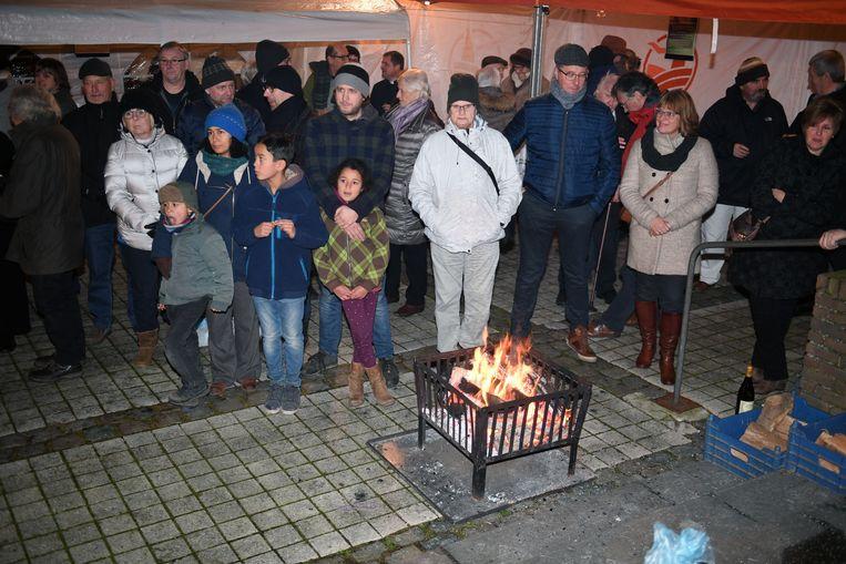 Verkoop van varkenskoppen op 'Feest van Sint-Antonius', een jaarlijkse traditie.