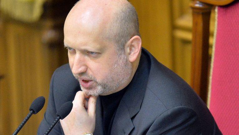 Interim-president Turchynov spreekt het parlement toe. Beeld afp