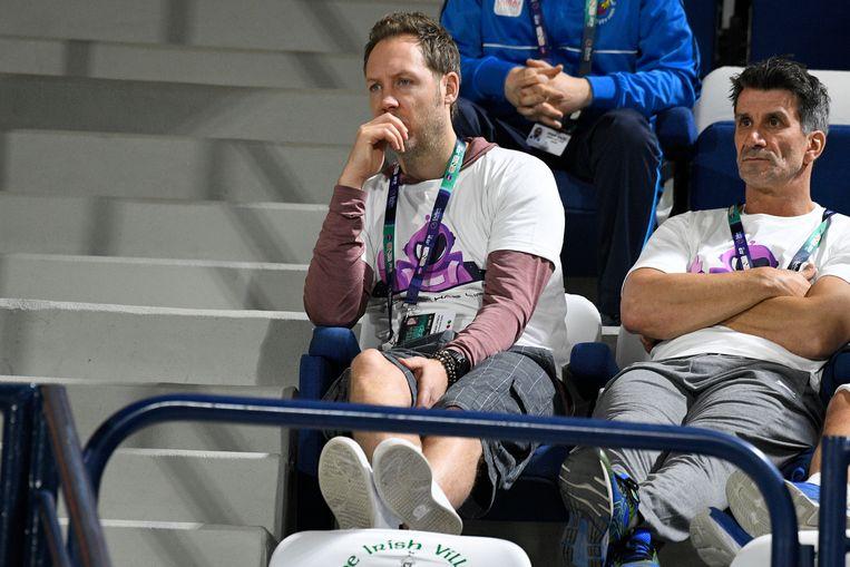 Clijsters' echtgenoot Brian Lynch en verzorger Jan Goosens.