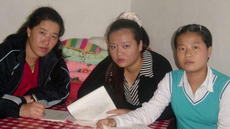 Grace Jo met haar moeder en zus in China in 2004.