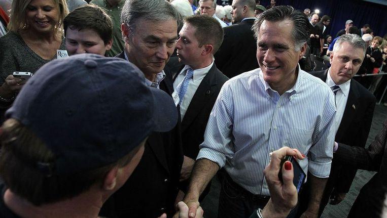 Mitt Romney begroet zijn supporters tijdens een campagne gisteren in Bexley, Ohio. Beeld afp