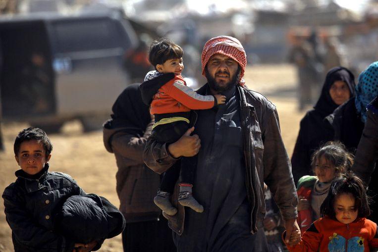 Syriërs op de vlucht. Beeld AFP