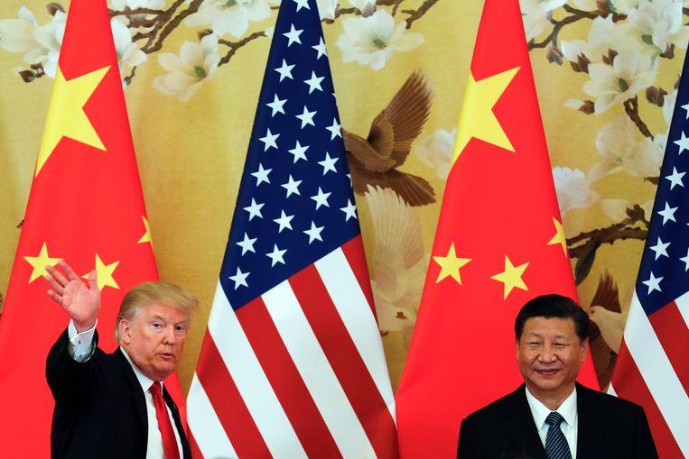 De Amerikaanse en Chinese presidenten Donald Trump en Xi Jinping. Badiou: 'De rivaliteit over het leiderschap van de wereld tussen de Verenigde Staten en China spiegelt wat er in de 19de eeuw gebeurde. Dat gaat uitmonden in nieuwe oorlogen.' Beeld AP