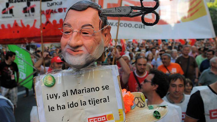 Spanjaarden protesteren tegen premier Rajoy. Beeld afp