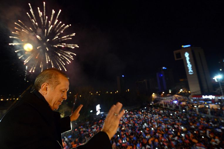 A March 30, 2014 handout picture released by the Prime Minister Press Office shows Turkey's Prime Minister Tayyip Erdogan greets his supporters in Ankara on March 30, 2014.   Turkey's Premier Recep Tayyip Erdogan claimed victory for his Islamic-rooted party in Sunday's key local elections and warned his foes they will