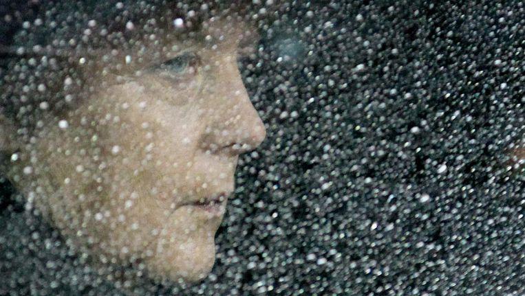 Bondskanselier Angela Merkel achter een raam in haar auto in 2012. Beeld epa