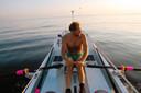 Mark Slats in zijn roeiboot.