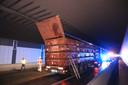 Het ongeval werd veroorzaakt doordat de achterwand van een opklapbare container plots open sprong.