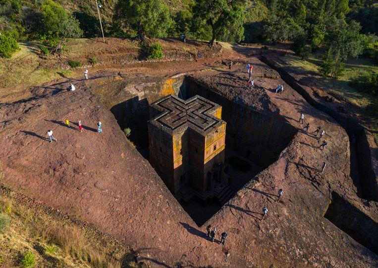 Uit de rotsen gehouwen kerk in Lalibela, in de Ethiopische regio Amhara. Beeld Getty