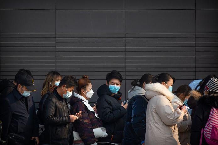 File à Pékin pour se faire tester, ce 22 janvier.